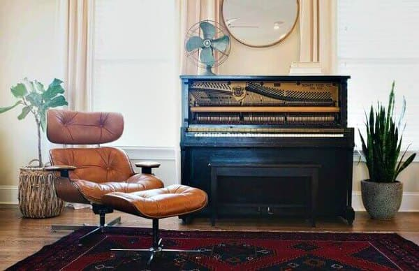 Piano and comfortable chair.